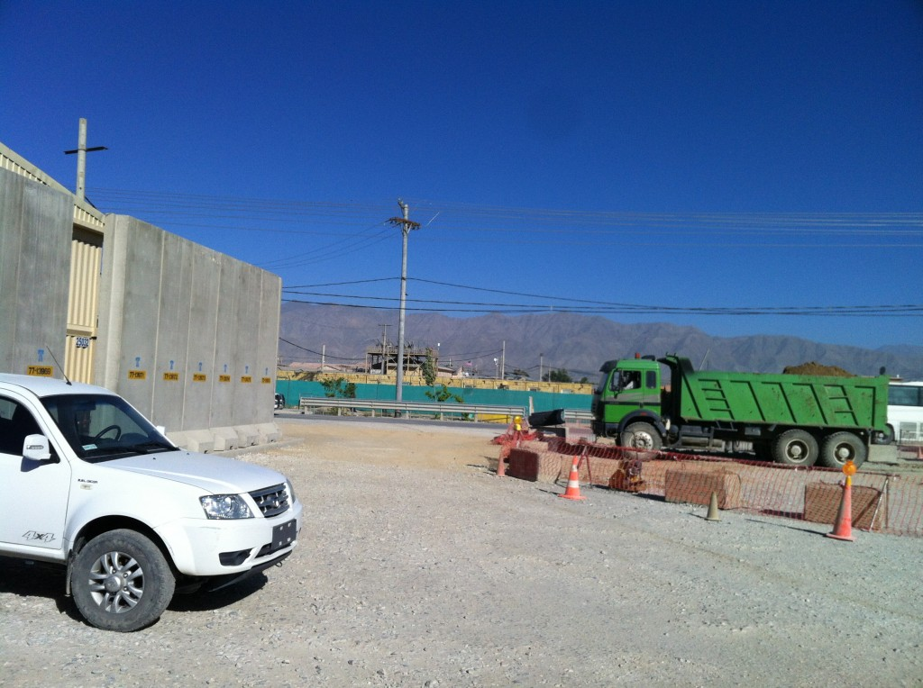 The T-Walls of cement fomr a different angle, as well as the huge mountains in the background where Bin Laden hid out