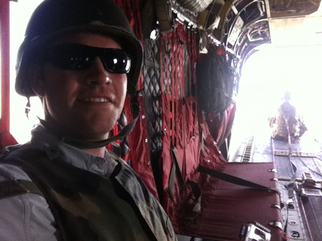 Some of us sit inside the Chinook, others sit with their legs dangling out the back...
